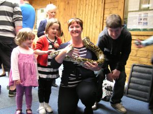 Hold a snake at the Indoor Discovery Zone