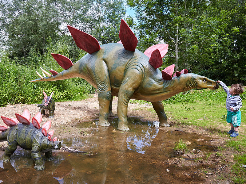 Child with dinosaurs Jurassic Journey Birdland Park Gardens 1 - It's Dino Weekend this May Bank Holiday!